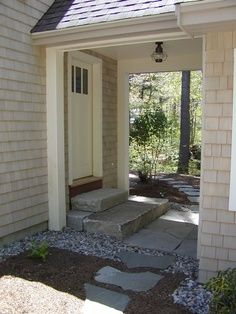 Oversized stone stairs, covered walkway to garage with lighting. Post it instead of attaching to do a floating slab foundation.