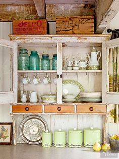 Antique crates above a primitive cabinet.