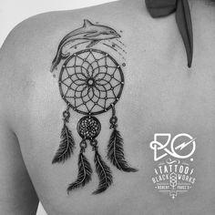 Dolphin, dreamcatcher, back tattoo on TattooChief.com