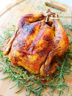 Easy Herb Roasted Chicken  Makes 6-8 servings  Ingredients  1 whole 5-6 pound chicken  1 1/2 Tablespoons olive oil  1 teaspoon kosher salt  1/2 teaspoon freshly ground pepper  1 teaspoon garlic powder  1/2 teaspoon paprika  1/2 yellow onion, cut into wedges  5 whole cloves garlic, crushed  handful fresh thyme, rosemary or parsley  Directions  Preheat oven to 425 degrees F.