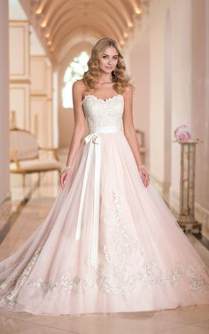 Stunning designer wedding gowns feature a glamorous charm in Tulle and Lace and scalloped Lace edging along the neckline. Exclusive designer wedding gowns by Stella York.