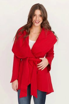 Red wide lapel coat with tie at waist.