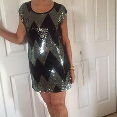 Mini dress with  sequins black and silver . JULIE S CLOSET sequined  flattering dress  - Plain black in back - silver and black sequins all over  front In a large  Chevron pattern  - size medium - fits 6/8 size- sophisticated, sexy. Julie s closet Dresses Mini