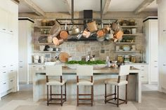 Napa kitchen with stone wall backsplash