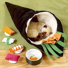 Home-made sushi cat bed. And they HAVE to sleep in it because they can't sleep in the box it came in. Home-made!