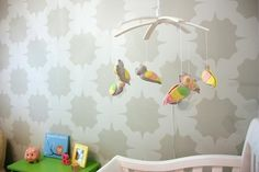 owl mobile and awesome wallpaper in a yellow and gray nursery