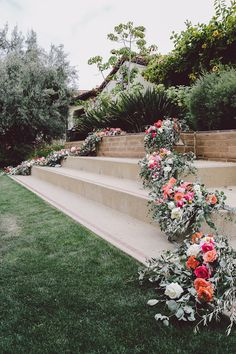 cascading floral decor - photo by Evangeline Lane Photography http://ruffledblog.com/tuscan-countryside-inspired-wedding-in-la-jolla