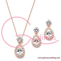 Brilliant CZ Halo Pear Shaped Rose Gold Necklace and Earrings Set This best-selling Rose Gold necklace and earrings set features brilliant Cubic Zirconia pear-shaped halos suspended from gleaming round-cut CZ tops. With sleek modern styling, a hint of vintage glam, and a medium-sized silhouette, this necklace set is a bridal and bridesmaids favorite. At just the right size, the zirconium pendant and earrings can jazz up a night on the town and add a touch of bling to a business suit or…