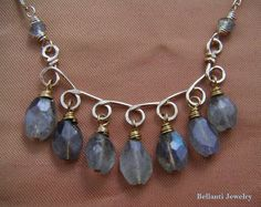 Wire Wrapped Labradorite Necklace - Gold Scroll & Labradorite Necklace - Wire Jewelry. $85.00, via Etsy.
