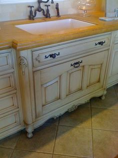 sink cabinet with feet, pull-out and counter bump out example