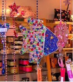 Pretty and colourful beaded suncatchers hanging. glass beads: http://www.ecrafty.com/c-2-glass-beads.aspx