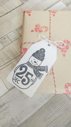 Xmas gift tags hand printed with cute snowman design. These large Christmas tags come in packs of 5 or 10 with red and white bakers twine to attach to your gift. I have hand carved my own original illustration onto rubber and hand printed onto hand cut tags using high quality ink.