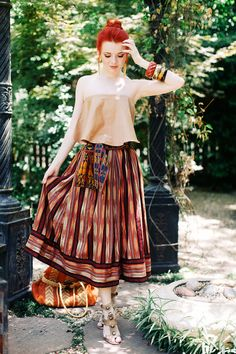nude top with tribal skirt