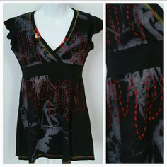 "Black detailed top Brand new with tags  Urban chic t-shirt with threaded details and beads at neckline. Black and gray with multiple color thread.  Small 100% cotton  Length approx 27"" Bust approx 16"" Tops Tees - Short Sleeve"