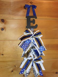 My very first cheer bow holder.  It's hard to find something that holds a pony-tail holder nicely, and I came up with this =)