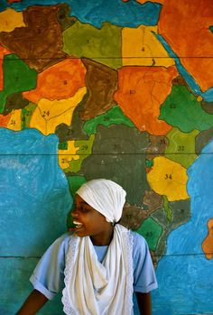 woman beside map of Africa