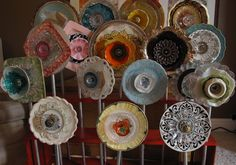 Plate Flower Garden Stakes//Looks like metal tubing, various sized plates, door knobs of assorted sizes.