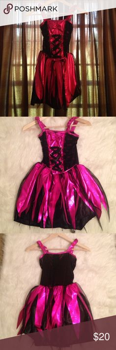 Girls Dark fairy costume. This has been through one Halloween and a few playtimes . But it is still in excellent pre owned condition the only flaw is ol that some of the pink is a little worn see in last picture . There is a place on the back to Velcro some wings add some black gloves ripped tights boots and some fantastic hair & itbibity Babbitt boo! You got a dark fairy on your hands ! No trades . Outfit is a 8/10 Costumes Halloween