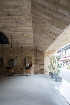 Oak boards cover the chamfered entrance to this hair and beauty salon in Osaka.