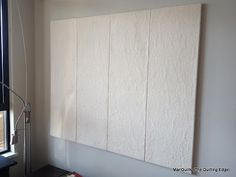 """Design Wall Tutorial; foam insulation board 3/4"""" x 14 1/2"""" x 48"""", duct tape, Command strips; cotton batting, temporary fabric adhesive.  Use Flannel"""