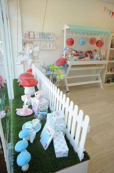 grass in window display - picket fence - candy canopy set up