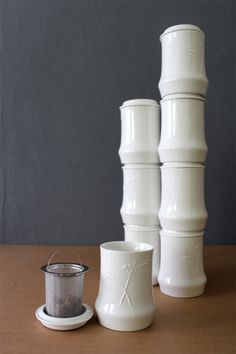 the 'bamboo up' collection takes this traditional way of drinking the herbal remedy is translated into a contemporary design. using the lid as a saucer,  the cups can be stacked up, forming the poetic shape of a bamboo tree.