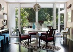 Angie Hranowsky Lakeshore dining room, zebra, pink, teal, saarinen