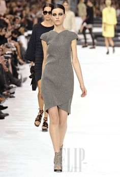 Chanel work dress in another color with a deeper scoop on the neck and the point on the leg angled to the left.