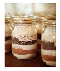 Wedding Mix-Up, A jar filled with layers of rich and gooey ingredients (cocoa powder, chocolate chips, marshmallows) for whipping up a toasty cup of cocoa.