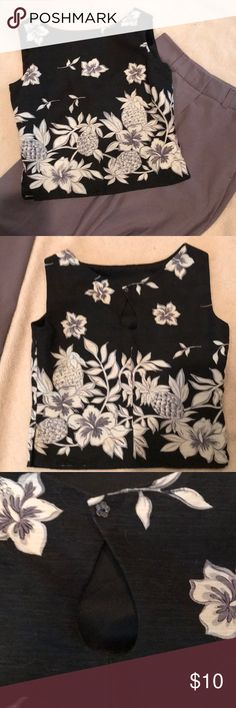 Tommy Bahama blouse size 2. Black / white Tommy Bahama size 2 top shell is 100% silk,  lining is also 100% silk,   The top is black and has white hibiscus flowers and pineapple (the flowers and pineapples are outlined in gray (it almost looks like a light purple). Tommy Bahama Tops Blouses