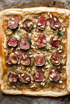 NYT Cooking: I used packaged puff pastry here because I thought the dense, almost candied figs would work well with an airy, flaky crust — one that I didn't have to make. The cheese and rosemary helps balance the intensity of the figs, while a drizzling of honey at the end brings out the sweetness of onions and figs.