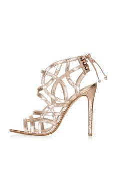 "Brides.com: 50 Metallic Wedding-Worthy Shoes ""Jacoba"" metallic nappa leather T-strap high heel sandal, $499.99, Ralph LaurenPhoto: Courtesy of Ralph Lauren"