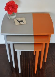 Retro orange and grey nest of tables.