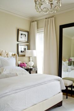 Beige is a neutral warm colour and extends a classic touch to any room. Beige gives you the flexibility to change your bedroom decor ever so often for its ability to gel with most colours. The cream-coloured drapes contrast well with the tall black framed mirror coupled with the stool. The white lamp on the bedside table blends in perfectly with the theme while the white linen on the beige bed welcomes you to sink into its comfort. Read more on our blog!