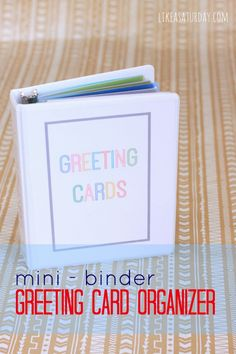 Greeting Card Organizer using a mini-binder (fully stocked with Hallmark Value cards - they run at 47 and 97 cents a piece!)