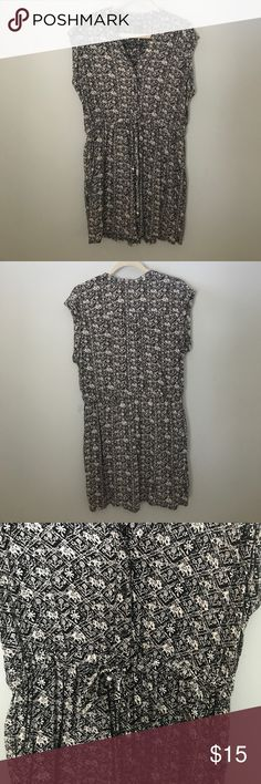 Black and White cinched dress Great condition! Only worn twice. Has tie in waist and has buttons on top half. Angie Dresses Midi