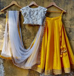 Yellow raw silk lehenga with a gorgeous gold border teamed with an off-white raw silk embroidered ruffle blouse with zardosi, pearl and sequins detail.Teamed with an ivory net dupatta.For your best friends wedding :)Composition:Lehenga, Blouse. Lehenga Designs Simple, Lengha Blouse Designs, Kids Blouse Designs, Half Saree Designs, Lehenga Blouse, Indian Blouse Designs, Simple Lehenga, Dress Indian Style, Indian Fashion Dresses