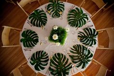 Monstera leaves were used as table mats for this beach wedding. #wedding #weddingdecor #tabledecor # monsteraleaf #palms #palmtree