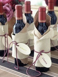 Kraft paper and off white fabric secured with cording~ stylish, all occasion wine wrap!