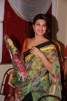 'Roy' actress Jacqueline Fernandez recently made an appearance at the wedding of her Personal Assistant, Ram's nephew. She seemed to be wearing a Masaba Gupta lehenga-saree in the wedding photos. Beautiful Bollywood Actress, Beautiful Indian Actress, Floral Print Sarees, Printed Sarees, Bollywood Saree, Lehenga Saree, Beautiful Athletes, Ethnic Fashion, Modern Fashion