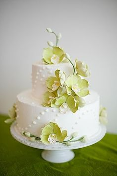 Modern wedding cake with green orchids - simple and elegant with a touch of tropicals