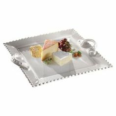 "Adorned with beaded trim, this beautiful earthenware tray lends a touch of elegance to your table.   Product: Serving trayConstruction Material: EarthenwareColor: WhiteDimensions: 2.12"" H x 14"" W x 10"" DCleaning and Care: Dishwasher safe"