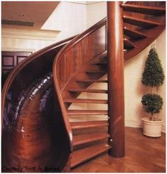 Beautiful wooden staircase and slide. No more problems with children sliding down bannisters.