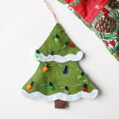 DIY felt Christmas tree is easy to sew and quick to make! Use this free tutorial to make ornaments or maybe even tags to put on Christmas presents. Christmas Tree Template, Fabric Christmas Trees, How To Make Christmas Tree, Beautiful Christmas Trees, Simple Christmas, Christmas Tree Ornaments, Christmas Crafts, Diy Christmas Decorations Easy, Christmas Coasters