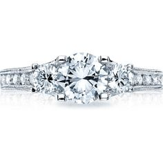 This graceful Tacori piece is shown with a brilliant round center stone, surrounded by round side diamonds, with channel set diamonds flowing across the ring body. The reverse crescent silhouette design on the side profile is given an elegant finishing touch with pave-set diamonds.