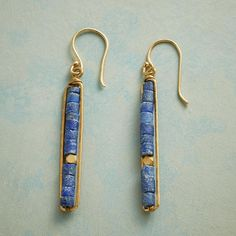"""LINEAR LAPIS EARRINGS--Lapis heishi beads aligned in a tidy stack make way for one faceted brass bead within a brass frame. Earrings with 18kt gold plated French wires. Handmade. 2-1/8""""L."""