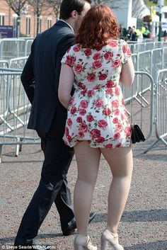 Cheeky! One lady shows off a little more than she bargained for in her very short rose-pri...