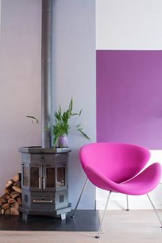 eclectic living room by Louise de Miranda; vivid band of color on tall wall with extremely cool chair