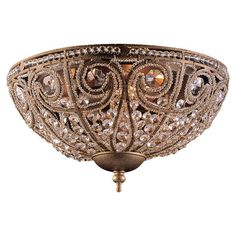 Cast a glittering glow over your foyer or den decor with this beautiful flush mount, featuring a scrolling openwork design and cut crystal accents.