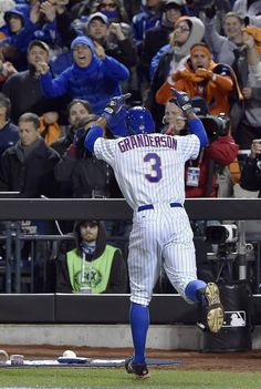 New York Mets right fielder Curtis Granderson celebrates after crossing home plate after he hit a two-run homerun in the third inning during game three of the World Series on Friday, October 30, 2015 at Citi Field in New York.